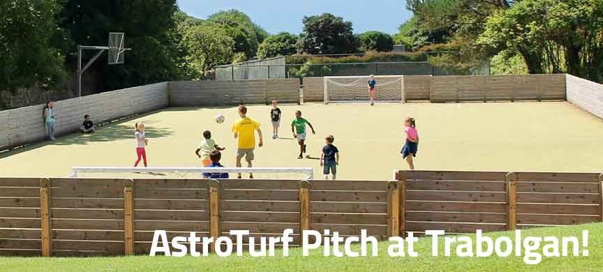 Children playing on the AstroTurf page at Trabolgan Holiday Village